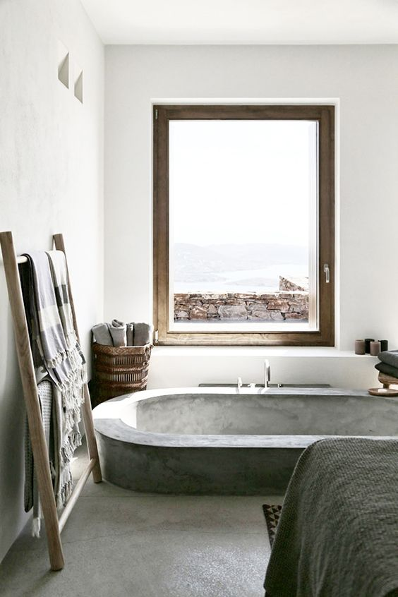 sunken concrete bathtub in the bedroom for a spa feel