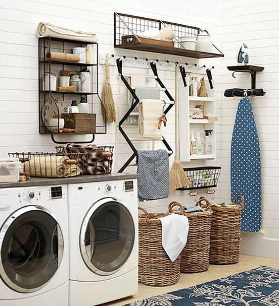 wall drying system aand baskets for clothes look nice and keep the space in order