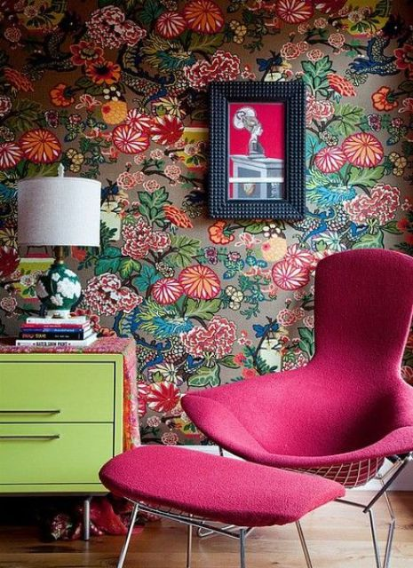 whimsy interior decor with a fuchsia chair and ottoman