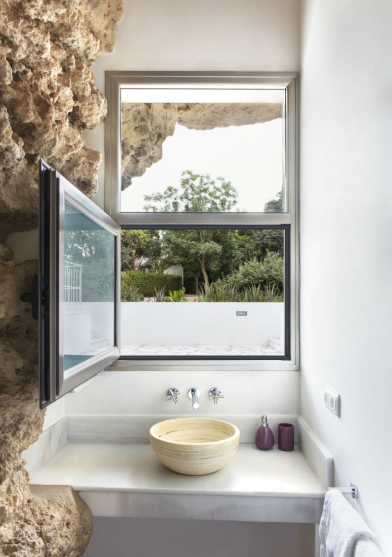 Bathroom overlooks the immediate green outdoors