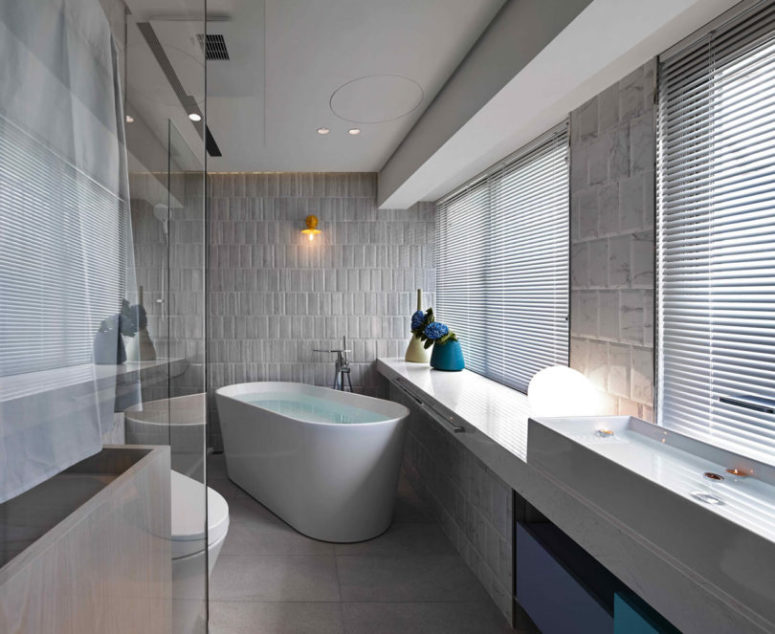 The free-standing bathtub is a cool feature and it perfectly matches the decor