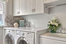 13 cabinets all over the laundry is a grey way to keep it uncluttered, keep them light-colored to visually expand the space