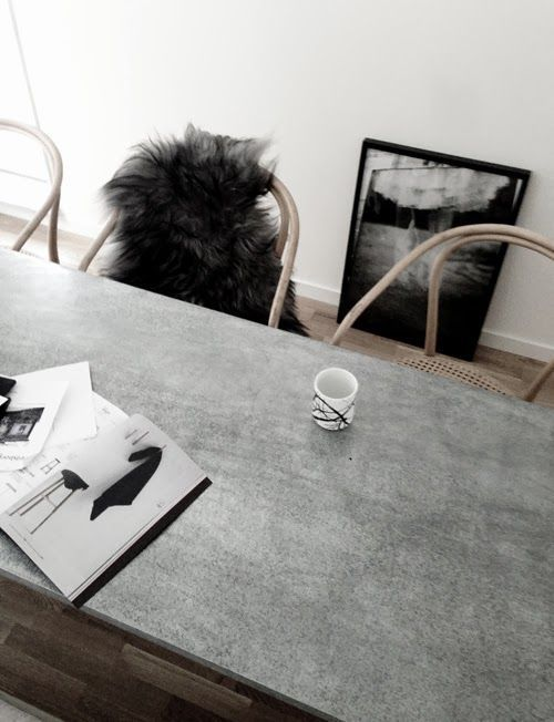 dining table with a concrete countertop