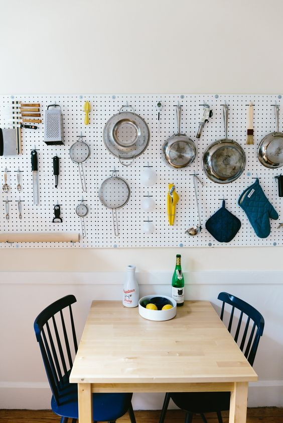 kitchen pegboard wall storage over the dining area