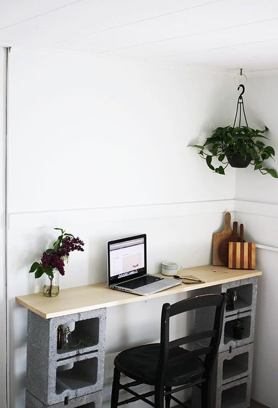concrete blocks as a base for a desk, they also have storage space inside