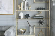 15 gold accent bookshelf and a picture frame in the same color