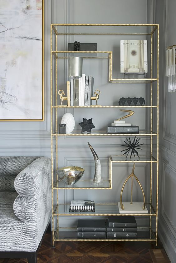 gold accent bookshelf and a picture frame in the same color