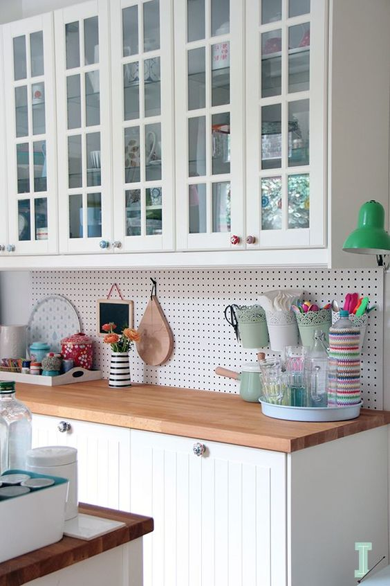 pegboard wall organizer instead of a usual kitchen backsplash