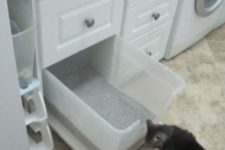 16 a pull-out litter box can be hidden among the laundry drawers