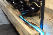 16 a reclaimed wood countertop with a resin insert