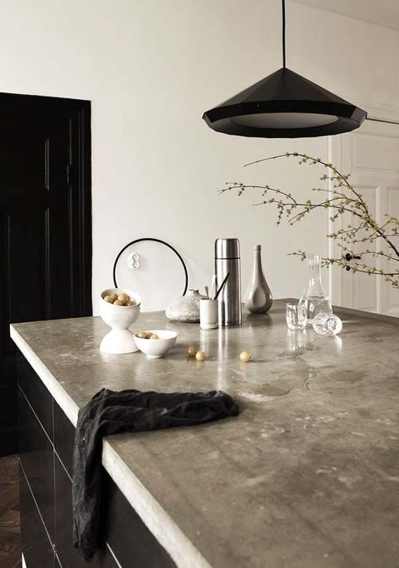 kitchen island with a polished concrete countertop