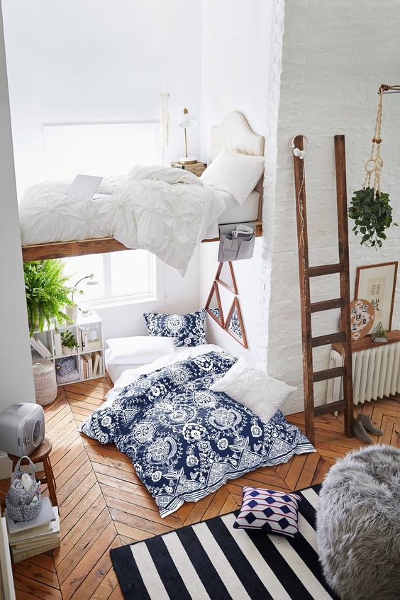 modern Scandi-inspired room with two sleeping spaces and textural textiles