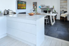 16 whitewashed wooden floors in the serene kitchen area and black tiles in the dining area