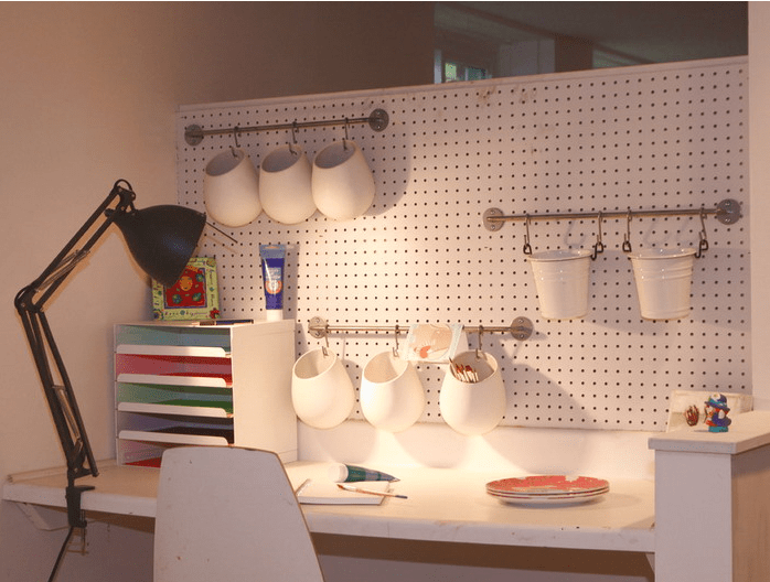 home office pegboard with rails and hanging organizers