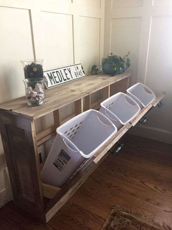 laundry plastic baskets can be hidden inside a wooden unit for a neat look