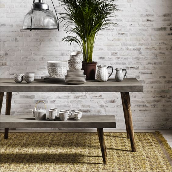 concrete dining set with a table and a bench