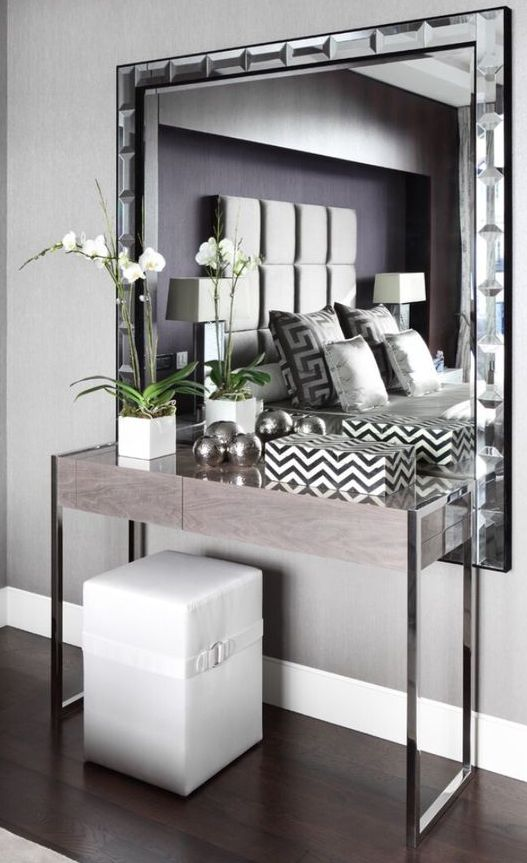 mirror layering with console legs and a sleek top surface