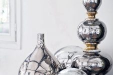 18 silver metallic vases and accessories look awesome in group