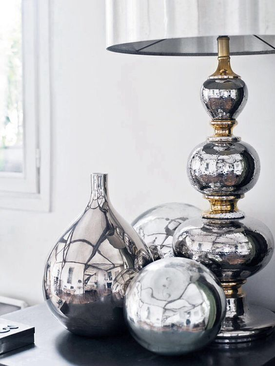 silver metallic vases and accessories look awesome in group