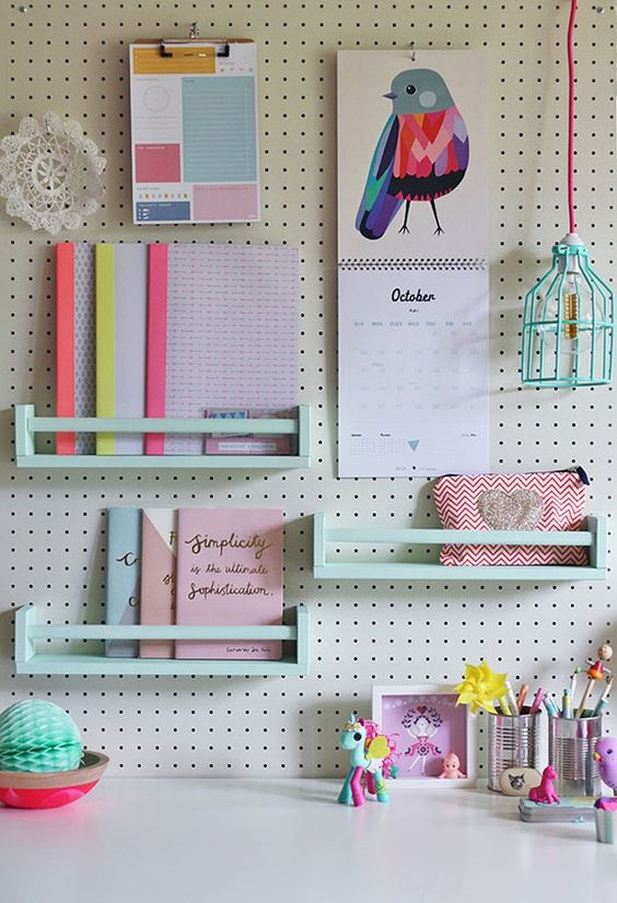 white pegboard with mint colored shelves is great for a girlish space