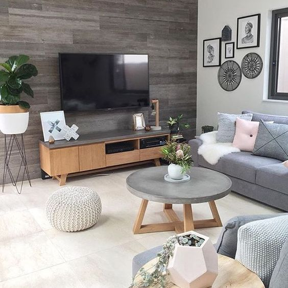 a concrete and wood coffee table and a TV unit covered with concrete