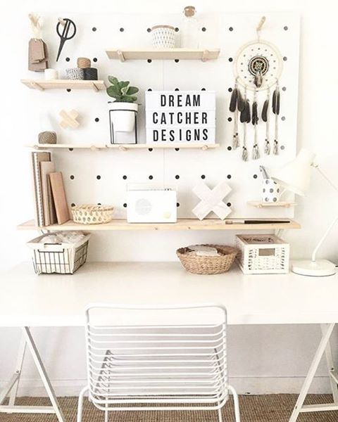 white pegboard with light-colored wooden shelves looks modern and refreshing