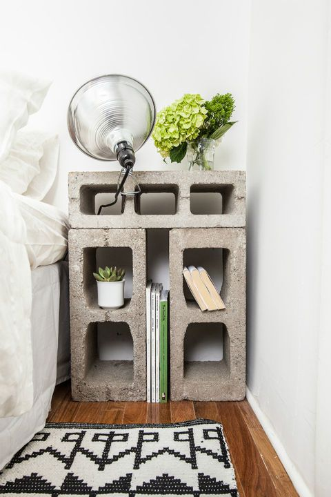 a nightstand made of concrete blocks looks rough and industrial