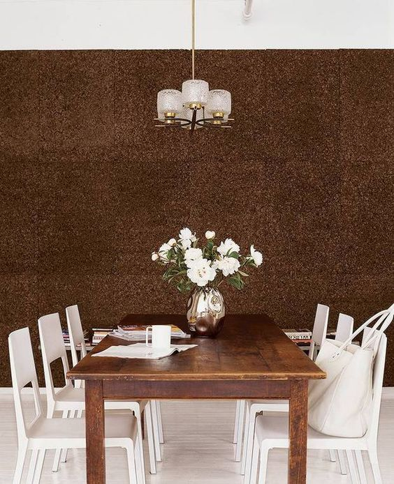 dark cork statement wall for a dining space