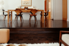 20 dark wooden floors with a raised level for accentuating the dining space