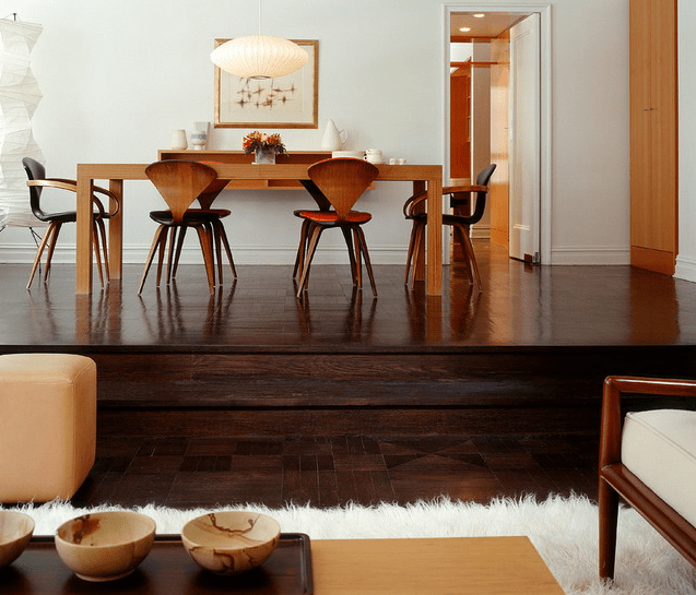 dark wooden floors with a raised level for accentuating the dining space