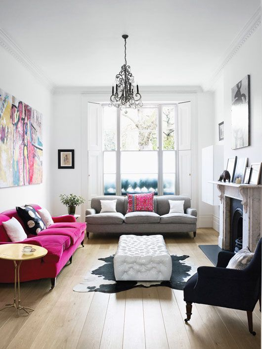hot pink sofa turns this living room into a whimsy space