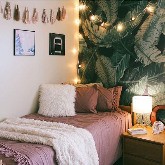 leaf-print statement wall, tassels, lights and faux fur