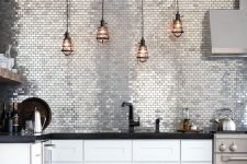 20 silver tiles and pipe lamp holder are to add a pretty textural touch here