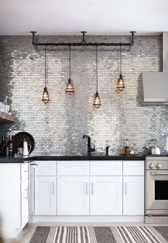 silver tiles and pipe lamp holder are to add a pretty textural touch here