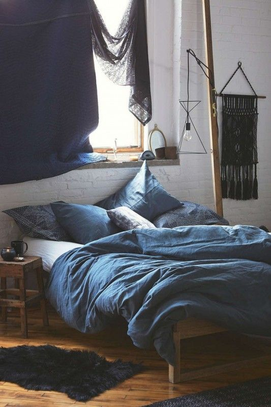 boho-style bedroom and bed wwith indigo bedding