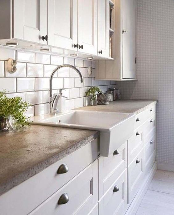 cozy traditional kitchen with a concrete countertop looks interesting