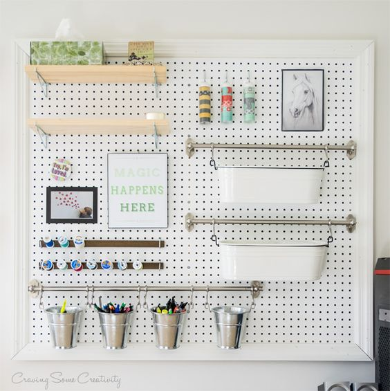 multi functional pegboard organizer with shelves, rails and magnetic stripes