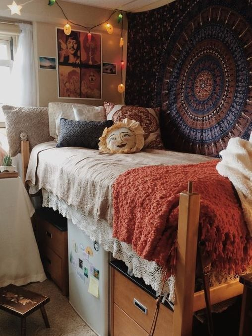 dorm room with a patterned rug on the wall and crochet blankets