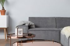 22 copper coffee tables in a group add an eye-catching touch to the peaceful room decor