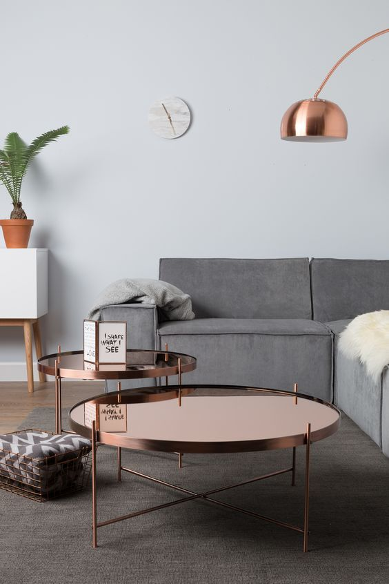 copper coffee tables in a group add an eye-catching touch to the peaceful room decor