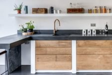 22 dark concrete countertop contrasts with light-colored woods