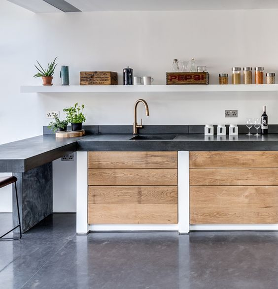 dark concrete countertop contrasts with light-colored woods