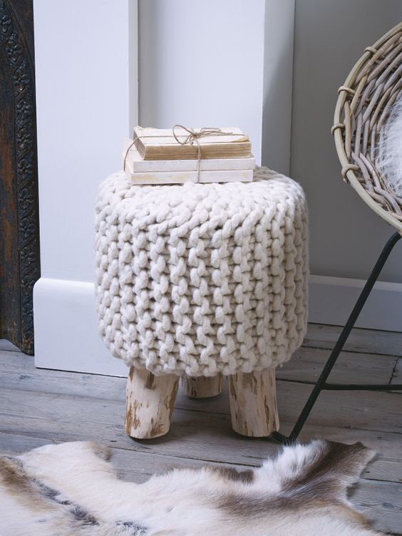 even a simple wooden stool can be covered with chunky knit and given a cozy look