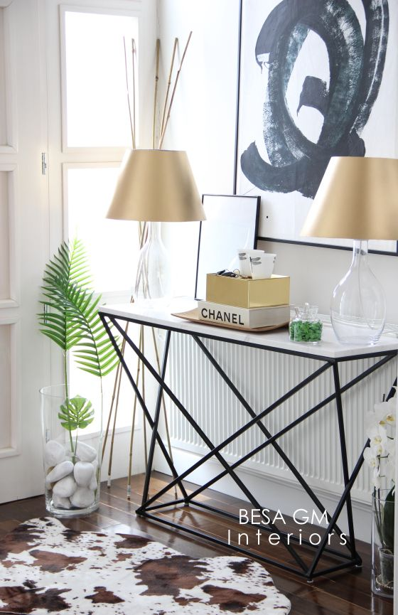 marble console table wwith whimsy geometric black legs