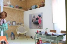 22 play space is accentuated with cork tiles on the walls and ceiling