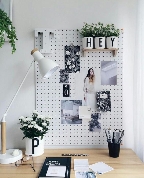 white pegboard with wooden shelves and to pin photos