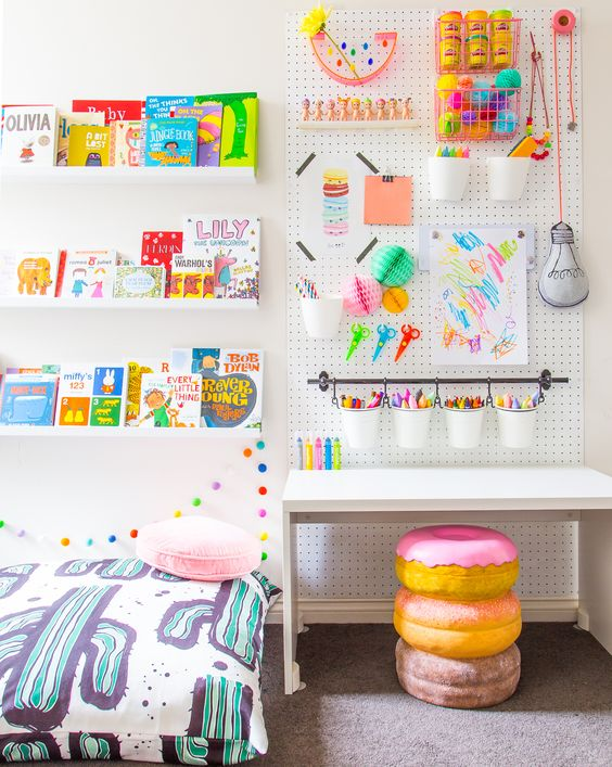 a pegboard in a kids' room is a great idea because all kids love drawing and crafting