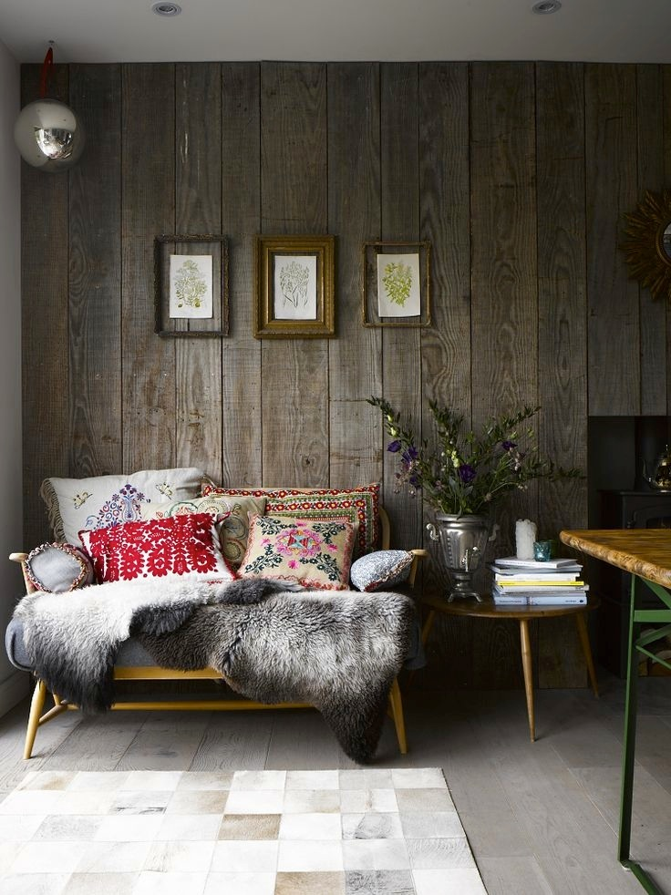 a weathered wood accent wall add a rustic feel and make the space unique