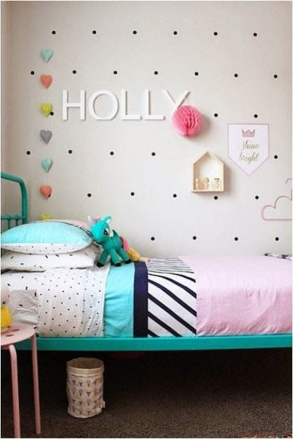 install a pegboard next to the bed to decorate the wall in a creative way and place some favorite toys