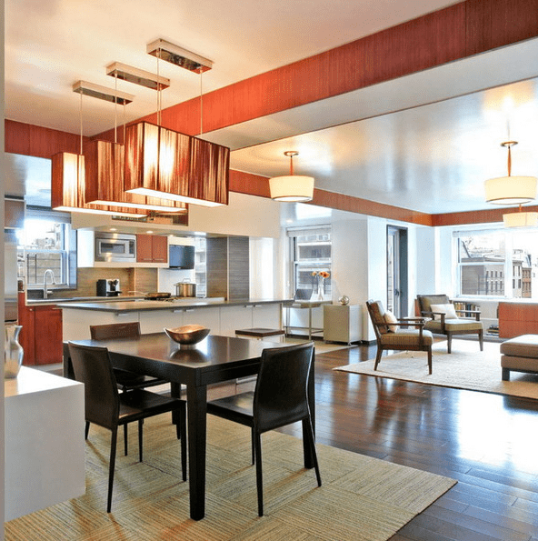 multi-level ceiling with various colors and lamps to separate the spaces